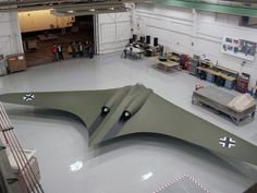 "..._The Horten Ho-229 flying wing fighter, first flown in 1944 by the Luftwaffe, rebuilt to exact specs by the model testing team at Northrop Grumman. The German prototype fighter/bomber designed by Reimar and Walter Horten and built by Gothaer Waggonfabrik late in World War II. It was the first pure flying wing powered by jet engines. Since the appearance of the B-2 Spirit flying wing stealth bomber in the 1990s, some describe the Ho 229 as ""the first stealth bomber""."