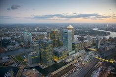 Dizzying Aerial Photos Of London: The Canary Wharf development with the Shard in far background.