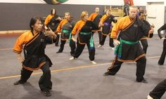 master Su Tong Yu leading monk Wise students in taijiquan (Tai Chi)