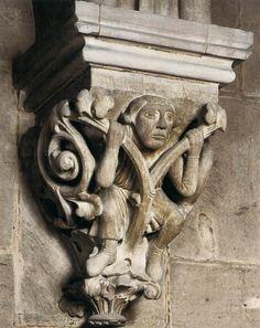 ROMANESQUE SCULPTOR, German, Man in vine foliage, c. 1240, Stone, Protestant parish church, Gelnhausen - Is he wearing ankle height socks?