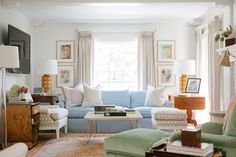 Collins Interiors - living rooms - eclectic living room, pinch pleat curtains, pinch pleat drapes, blue sofa, blue couch, blue slipcovered s...