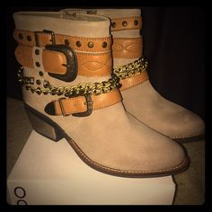 """ALDO boots Great """"western"""" inspired ALDO boots! These boots come up a little past the ankle and have a 1 .5 inch thick heel. The belt and chain wrap detailing along the top add a real western yet bohemian feel to them. They are genuine leather throughout. Never worn, in perfect condition. Perfect for a fall day!  ALDO Shoes"""