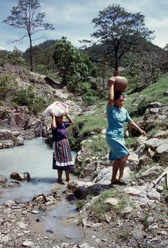 Women bringing water to their homes from the community's traditional water source in San Antonio, Lempira, Honduras