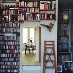 Shelves up to the roof. And the ladder of course. Shelving Systems, Small Spaces, Bookcase, Shelves, Interior, Furniture, Libraries, Home Decor, Ladder