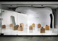Japanese designer Soichi Mizutani used computer algorithms to create a human-sized cave for Tokyo's Iguaneye Aoyama shoe store