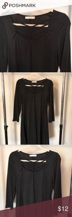 Black Tunic Dress Black Tunic Dress with interesting detail on the top. Boutique purchased, worn once! Fits size 2-6, cute with tights in winter and on its own in the summer! entro Dresses Mini