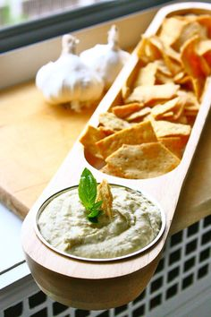 White Bean and Garlic Dip....This would count as a Carb on the BodyBuilding plan I am on right now but at least beans are allowable in a large quantity than starches, and If you use veggies instead of chips, this would be a nice addition to a meal! Next wine party, I am bringing this!
