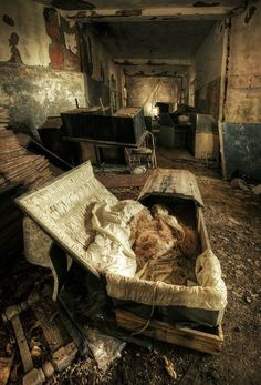 Asylum photography . . . Is that a coffin?  Yeah, that's bound to make a mentally ill person feel much better. . . duh. . .