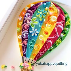 Love the colored background with a little quilling in each color!