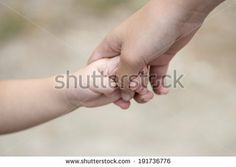 Hand mother and daughter  by pattyphotoart, via Shutterstock