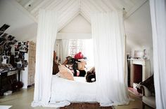 Make a cozy, romantic space with curtains.  DIY! Use a simple and affordable tension cable and you can have curtains anywhere!