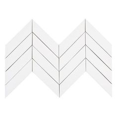 """Kiln Chevron Milk - White Ceramic Tile - Our 2x8 ceramic Chevron tile in the color """"Milk"""" is a classic white. There are 9 2x8  tiles per square foot of material and they are shipped loose for easy installation. This tile is well suited as kitchen backsplash tile, bathroom tile or as any indoor wall tile. All Kiln Ceramic Chevron tiles are handcrafted in the USA. Our artisans take care to ensure the highest quality of workmanship goes into every step, from clay extrusion, to hand cutting, to…"""