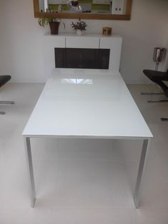 Cosmopolitan extendable glass dining table in white with Chrome steel frame and legs. Fully extended to Tall sideboard is from our NAT range, NAT in matte white. Extendable Glass Dining Table, Tall Sideboard, Leather Bed, Sofa Design, Cosmopolitan, Modern Bedroom, Contemporary Furniture, Steel Frame, Mumbai