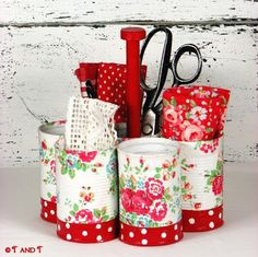 .organizer made of soup cans could be used with utensils, wooden spoons, spatulas etc