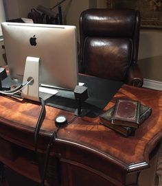Basement Office Space Hooker Leather Executive Chair and Executive Office Desk...modern vintage chenille tapestry in background..perfect out of the way kid space