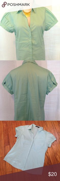 XL The limited button up blouse light blue teal This size extra-large the limited brand short sleeved button up blouse is in good used condition. Is a light blue/seafoam/teal color. Adjustable sleeves with buttons to make them smaller or bigger. Has a super tiny super light stain on the back of the shirt. Please see photos. Please ask any questions before purchasing. The Limited Tops Button Down Shirts