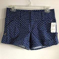 Delia's navy with white polka dot shorts. Delia's navy blue with white polka dot shorts. Cute pockets and cuffed hem. Size 1 - 2. 97% cotton and 3% spandex. New with tags. Delias Shorts