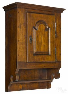 "Chester County, Pennsylvania walnut hanging cupboard, ca. 1780. 29"" h. x 18"" W."