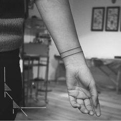 Minimalist wristband tattoo. Tattoo artist: rachainsworth