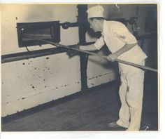 Man in a PW uniform baking bread; circa 1940-1945 :: Mississippi Armed Forces Museum