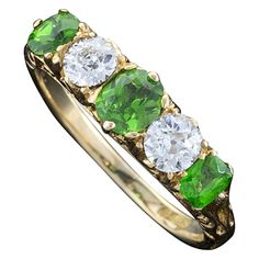 Antique Demantoid Garnet Diamond Ring | From a unique collection of vintage more rings at http://www.1stdibs.com/jewelry/rings/more-rings/