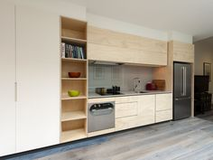 natural timber & white mixed with stainless with a black frame highlighting the overhead cabinets   Constructed entirely of ply, this compact solution is built for style and function, showcasing Cantilevers furniture crafting skills and precision with detail.