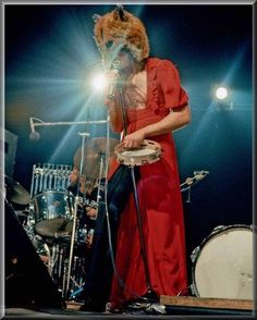 Peter Gabriel in red dress and fox head