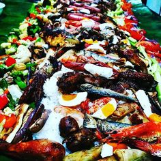 Boodle Fight. A Filipino way of serving food for guests. It's a variety of mixed dishes on top of the rice and spread on banana leaf. It's usually practiced during 'fiestas' and other special occasions. #food #foodie #tradition #culture #cuisine #dishes #hospitality #hosting #delicious #yummy #nomnom