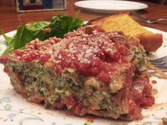 Whole wheat lasagna noodles smothered in a rich marinara sauce, layered with a rich, creamy, tofu spinach ricotta 'cheese…the perfect vegan lasagna!