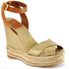 Tory Burch Fabian Linen Metallic Espadrille Wedge Sandal Season! Great metallic canvas golden toned crisscross style paired with a cognac tan leather ankle strap. Rope wedge. Like new! The Chic Shed; A Current and Classic Fashion Curation.  10% OFF BUNDLES I ❤️ THE OFFER BUTTON ❌NO PP, TRADES, HOLDS❌  15% OFF RETURN BUYER BUNDLES Tory Burch Shoes