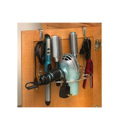 The Over-the-Door Hair Dryer Holder Multi-Rack stores your hair dryer curling irons and other hair accessories right inside the vanity door.