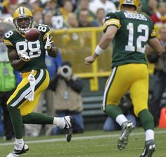 Aaron Rodgers throws a pass to Jermichael Finley:  Packers 38, Redskins 20