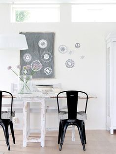 Anna-Malin's home in Sweden via decor8 - love the smoky grays, black and white, tolix chairs, flowers, I could go on...