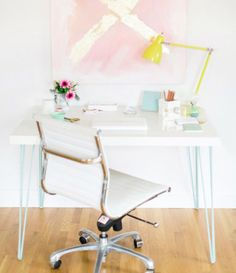 Clever Ikea hacks. white desk with blue hairpin legs.