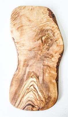 I'm a sucker for organic shapes and textures.  This olive wood cutting board is a winner.