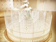Garden by Super-nature-design  the artwork consists of patterned circular layers made from paper.