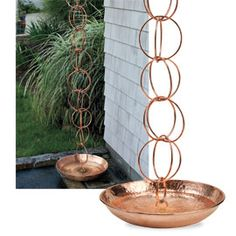 Replace a distracting downspout with the artistic Rain Chain and Basin.    A downspout may do the job of draining gutter water, but Rain Chain turns the process into an aquatic ballet that will charm you every time it rains. Elegant copper links won't rust. Add the optional water-catching Rain Chain Basin to complete the artsy look.
