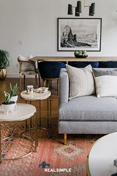 22 Chic and Clean Modern Living Room Design Ideas | Who said you can't mix other styles into a modern space for a vintage look? Take note from Becki Owens, as she included a vintage rug in her chic and modern living room design, which brings a surprising element to the space. #realsimple #livingroomdecor #livingroomideas #details #homedecorinspo