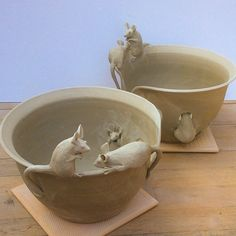 """Six mice ...on two yarn bowls."""