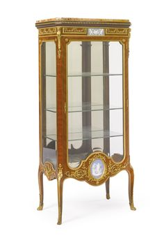 François Linke French, 1855 - 1946 A Louis XVI style gilt bronze-mounted kingwood and jasperware vitrine Paris, early 20th century |