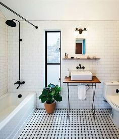 Subway tile shower - love the dark faucet and shower head