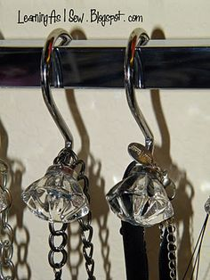 Shower curtain hooks and a towel rod for jewelry organization