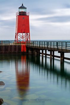 Charlevoix, Michigan Lighthouse with Reflection. Photographed on a rainy day near sunset by Kenneth Keifer.