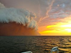 It was a massive dust storm, capped with a solid white shelf cloud!