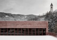 Italian studio Pedevilla Architects has used red pigmented concrete to give an Alpine fire station in South Tyrol a muted yet distinctive…
