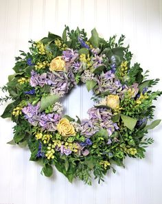 This beautiful dried flower wreath is the perfect wall decor for your home or cottage! It features gorgeous lavender-colored hydrangea that