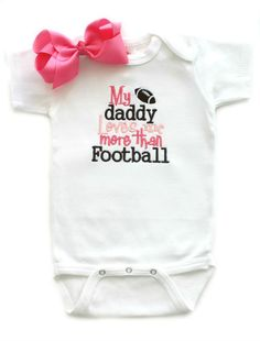 Daddy Loves Me More Than Football w/ Bow NFL Sports Baby Shower Gifts | All That Sass Boutique  http://www.allthatsassboutique.com/collections/retail/products/daddy-loves-me-more-than-football-w-bow