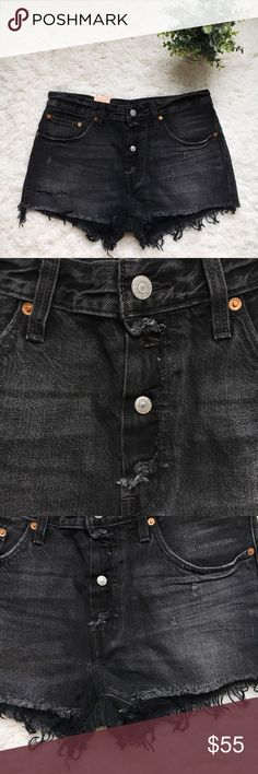 """Levi's 501 denim black distressed shorts 30 NWT Levis 501 original fit distressed black denim shorts, button fly, straight leg and frayed hem.  Size 30 Waist: 32"""" Length 12"""" Rise: 10 1/2""""  Brand new with tags. All my items come from a smoke free home. If you have any questions just ask! Levi's Shorts Jean Shorts"""