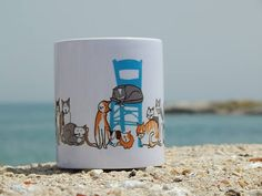 A quality printed: mug with base stamp in my Greek Cats design Packaged in a sturdy mug-box. Greek Cookies, Marble Coasters, Cat Design, Packaging Design, Ceramics, Mugs, Tableware, Prints, Etsy