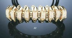 """A DIAMOND AND 18K GOLD """"CELTICA"""" BRACELET, BY BULGARI"""